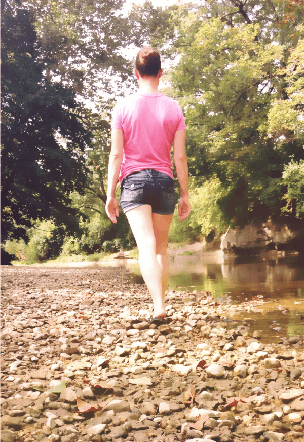 Photo of Shawna Brown traveling by a river